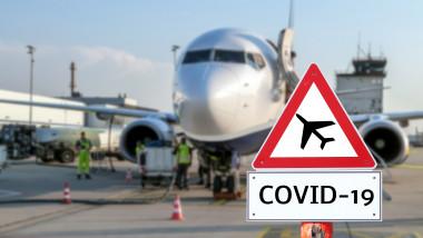 avion la sol cu semn de coronavirus in fata