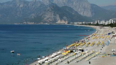 Tourists enjoy a beach in the Mediterranean resort city of Antalya