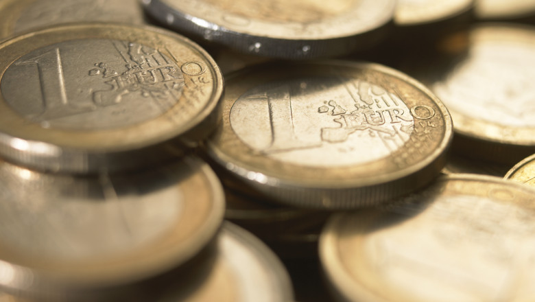 Euro Currency: Pile of 1 euro coins, close-up
