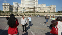 Tourists-photograph-one-another-in-front-of-the-Palace-of-the-Parliament