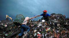Children Juggle Scavenging With School At Jakarta Landfill Site