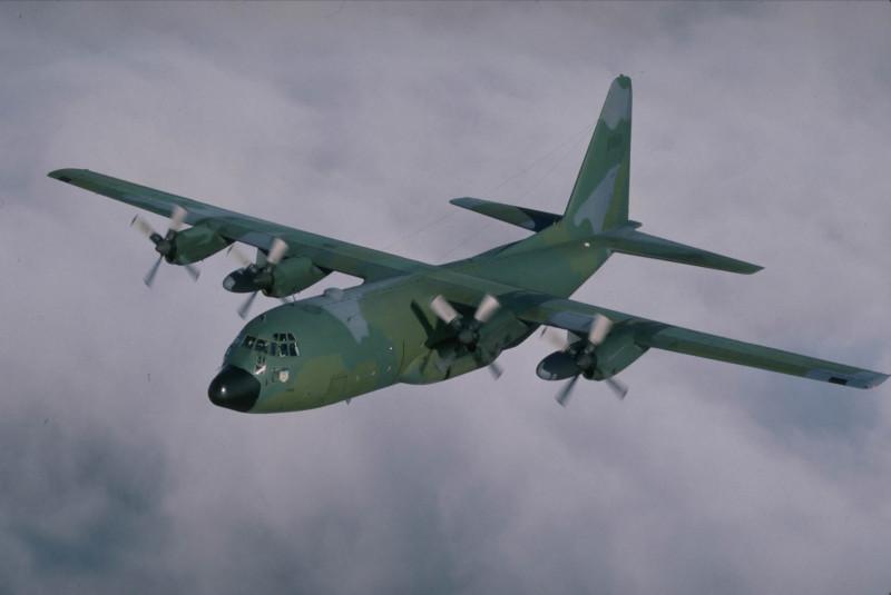 US National Guard C-130 Hercules Flies Over The Cloud