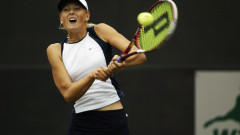 Maria Sharapova returns a shot