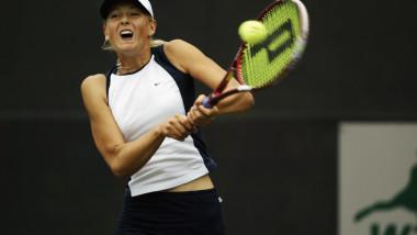 Maria Sharapova returns a shot