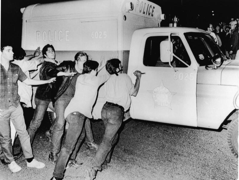 Protestors Push Police Vehicle At 1968 Democratic National Convention