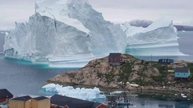 Iceberg grounded outside village in northwestern Greenland
