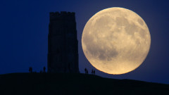 Blue Moon Rises Over Glastonbury Tor