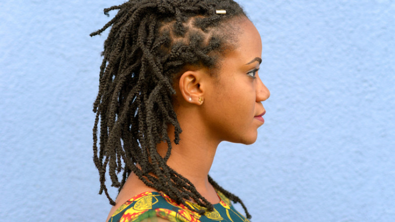 Side view portrait of a woman with dreadlocks