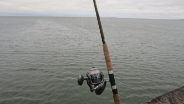 ROD AND REEL ON PASCAGOULA BEACH PIER