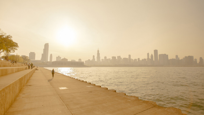 A heat wave and smog on the shoreline of a cityscape