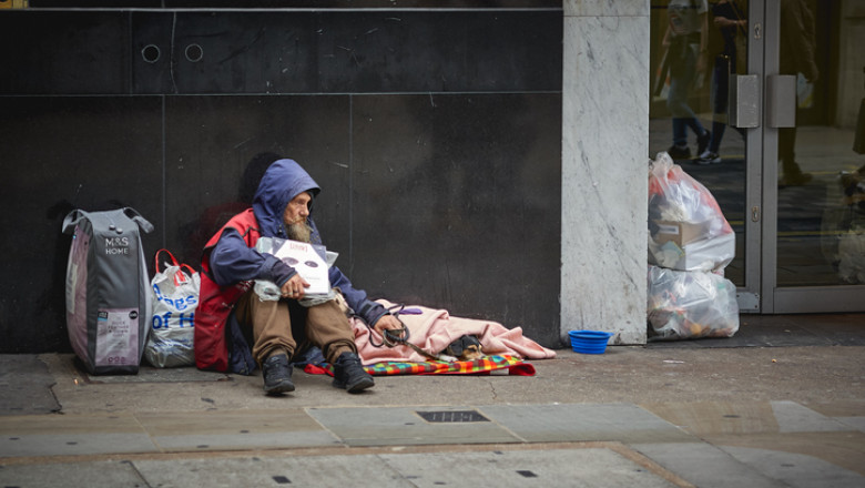 A homeless man begging for help in central London.