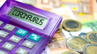 Calculator, Euro banknotes and coronavirus in Europe