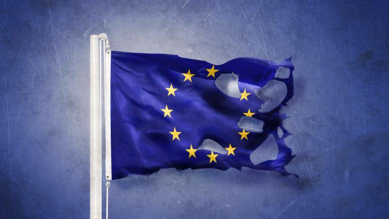 Torn European Union flag against grunge background