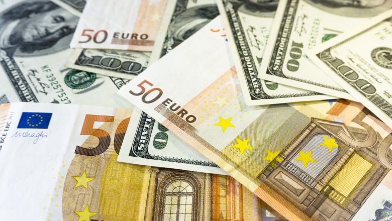 A pile of one hundred dollars USD and fifty euros EUR background close. Money and financial concept