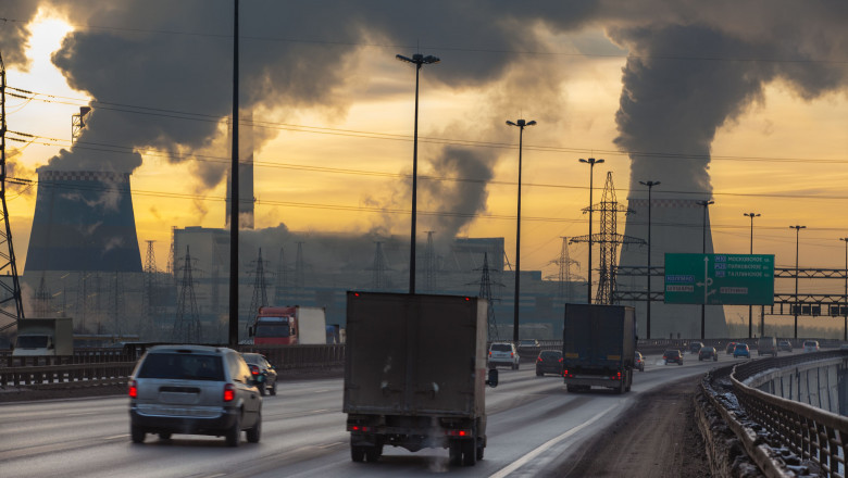 City ring way with cars and air pollution from heat electric generation plant in Saint-Petersburg, Russia