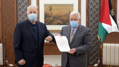 Palestinian President Mahmoud Abbas, hands over the election decree to the head of the Central Election Commission Nasser Hanna, Ramallah, West Bank, Palestinian Territory - 15 Jan 2021