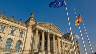 The EU and German national flags flying outside the famous Reichstag parliament building, Berlin, Germany, Europe