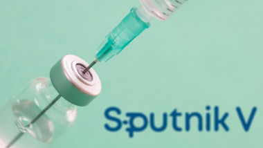 Athens, Greece. December 17, 2020. SPUTNIK V vaccine, Coronavirus immunization concept. Companys logo on blue background. Covid19 vaccine vial and syr