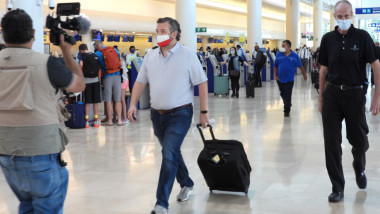 Ted Cruz checks in for a flight at Cancun International Airport after a backlash over his Mexican family vacation as his home state of Texas endured a Winter storm.
