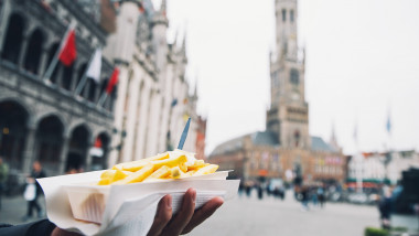 French Fries with mayonnaise on the background of city tourist streets of Bruges Belgium.