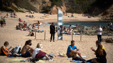 A metallic monolith appears on a beach in Catalonia