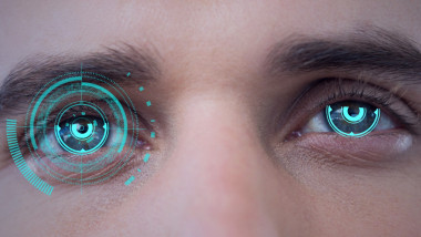 Digital composite image of round scanner against close up of male human eyes