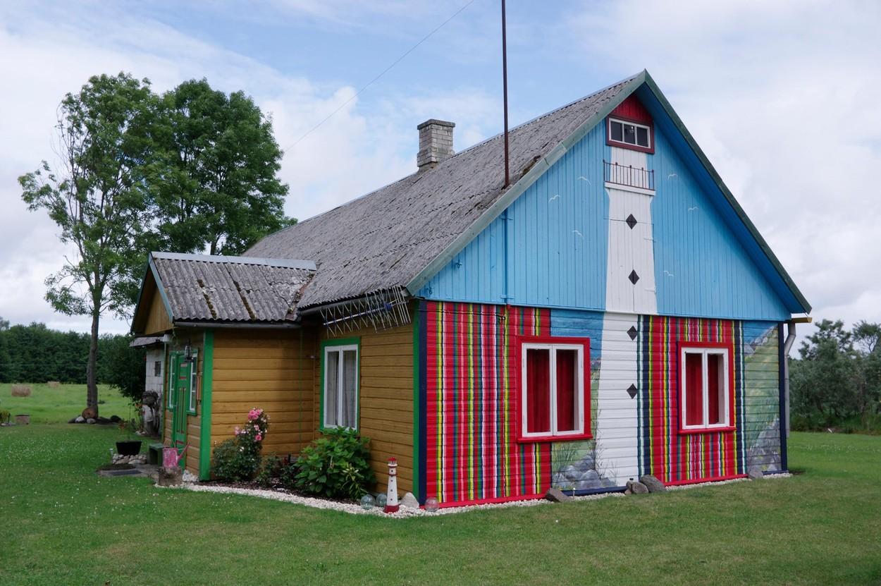 The facade of the House painted Kihnu skirt colors. Kihnu Island, Estonia 5th August 2017