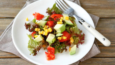 nutritious salad with avocado, tomatoes and corn, healthy food