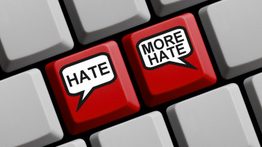 Hate and More Hate - Hate concept on red computer keyboard