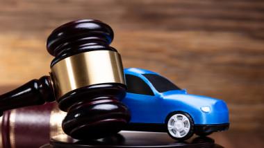 Gavel And Blue Car Near Law Book