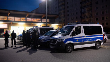 Berlin, Germany. 17th Mar, 2021. Federal police forces stand in a parking lot in Berlin-Lichtenberg and prepare for a raid. In the raid against smugglers accused of human trafficking and forced prostitution, officers searched numerous apartments in Berlin