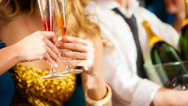 a couple with champagne in club or at a party