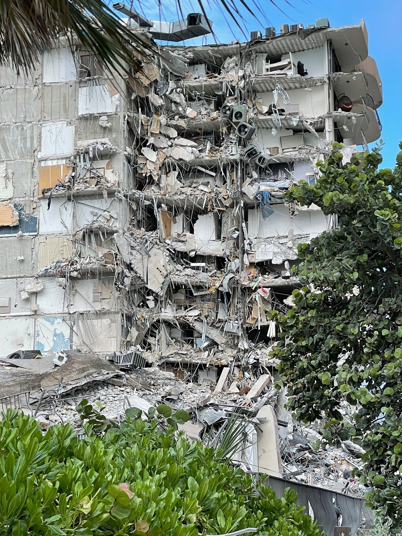 Oceanfront Miami Beach condo tower collapses leaving at least one dead.