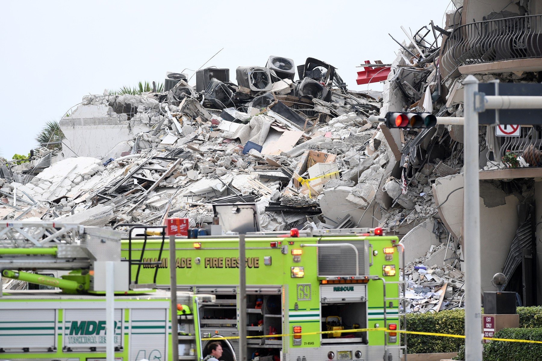 Massive rubble pile is seen at location of residential condo collapse in upscale Miami Beach neighborhood