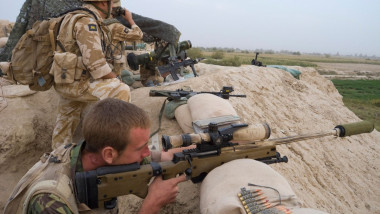 British Army sniper looking through sight in Helmand province Afghanistan