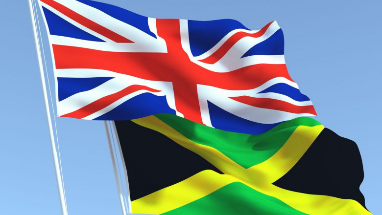 Two waving state flags of United Kingdom and Jamaica on the blue sky. High - quality business background. 3d illustration