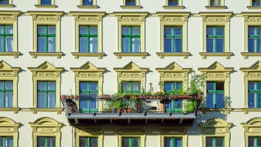 Facade of a green renovated old apartment building seen in Berlin, Germany