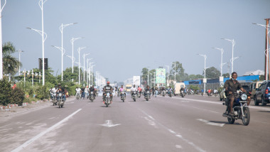Bikers demonstrate outside the Congolese Parliament in Kinshasa