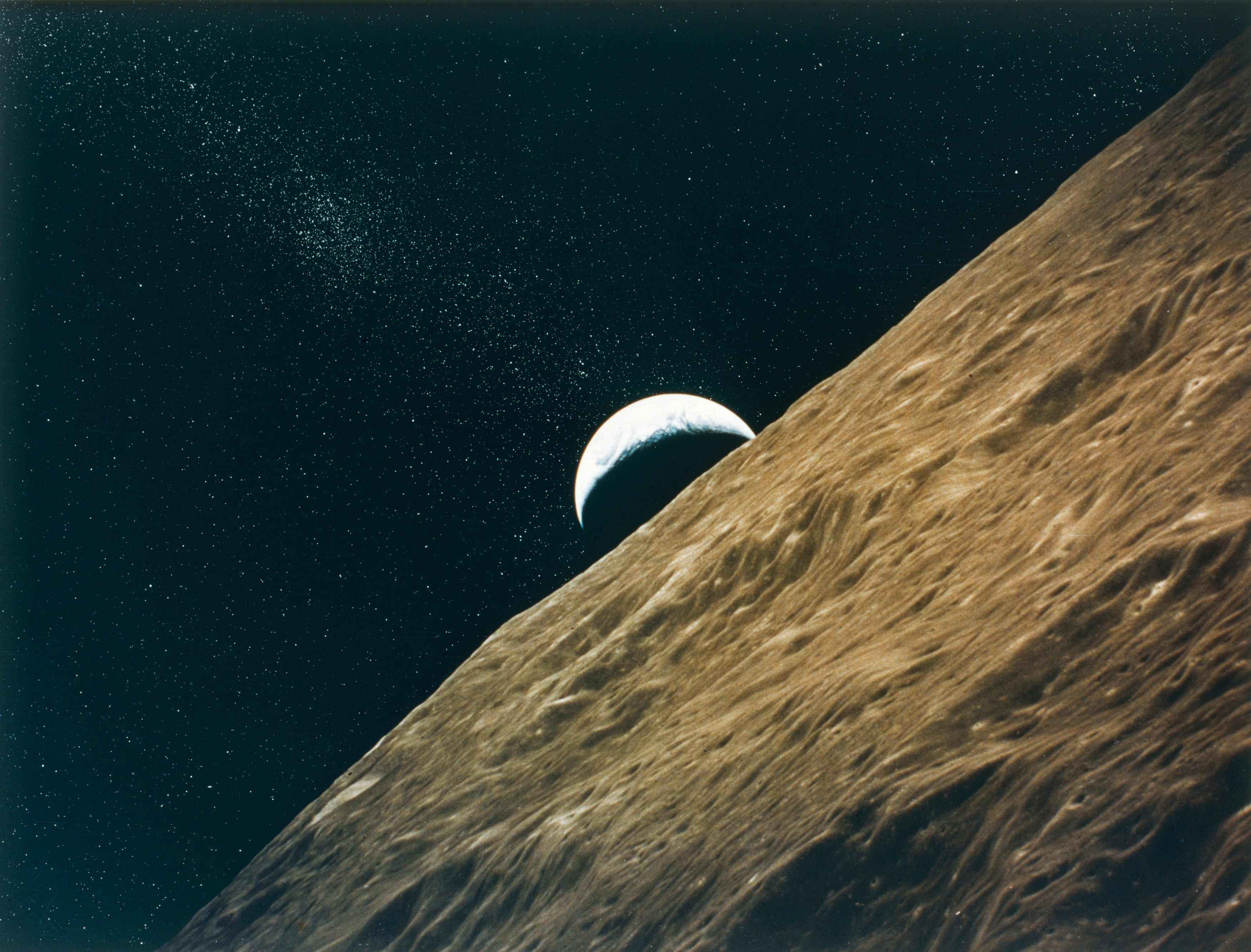 Earth rising above the Moon, seen from Apollo 15, July-August 1971. Creator: NASA.