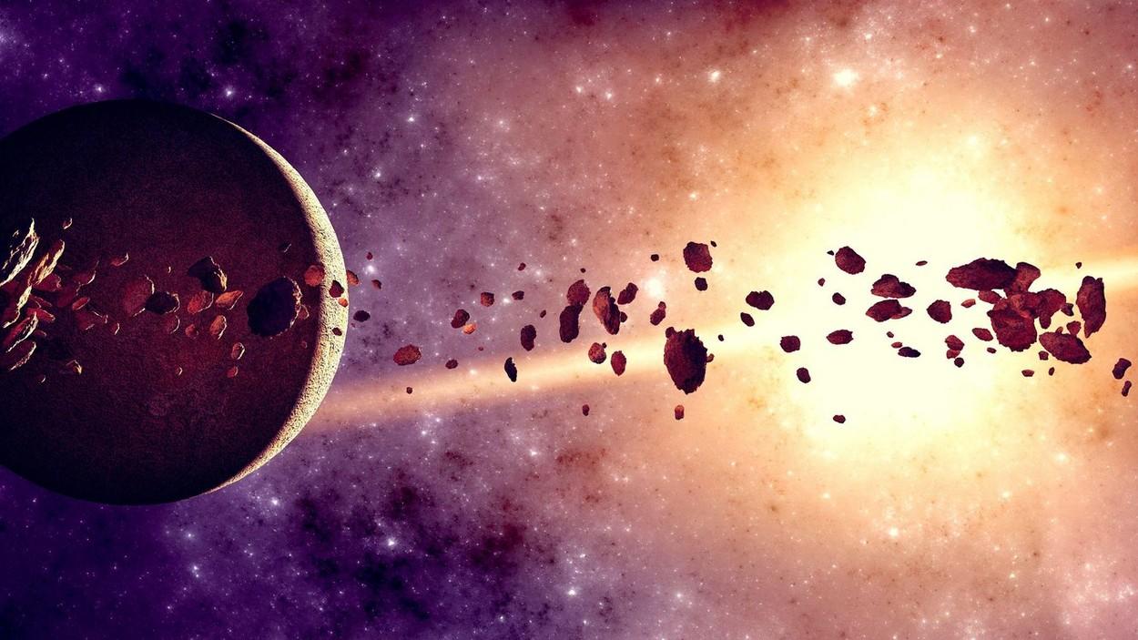 Doua roci roşiatice uriaşe, cu materie organica complexa, identificate de oamenii de ştiinţa in centura de asteroizi