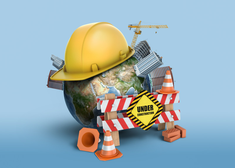 3d rendering of Earth globe, covered with a construction helmet, small buildings and with a fence with a sign Under Construction.