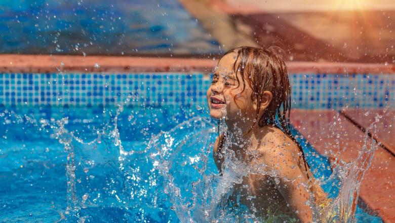 Happy Little Boy Having Fun in the Pool