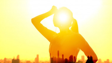 Double exposure portrait of young fitness Woman hand wiping sweat and summer heat wave concept