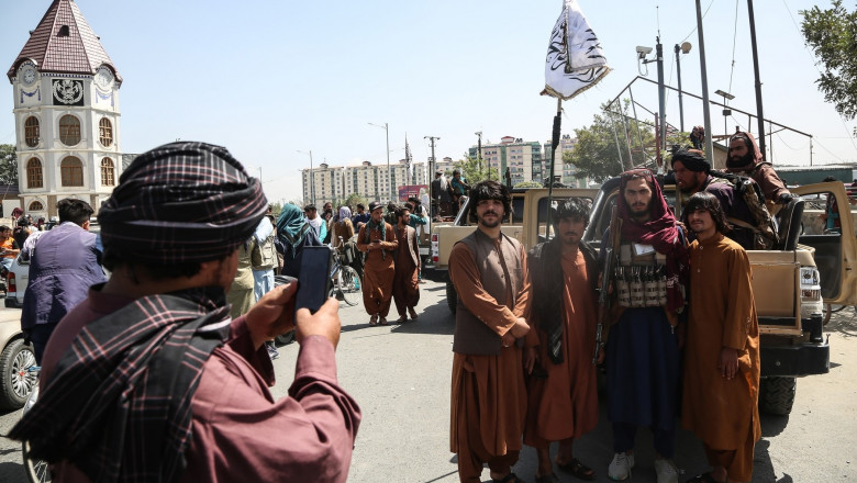 Taliban fighters pose for a photo in Kabul, Afghanistan
