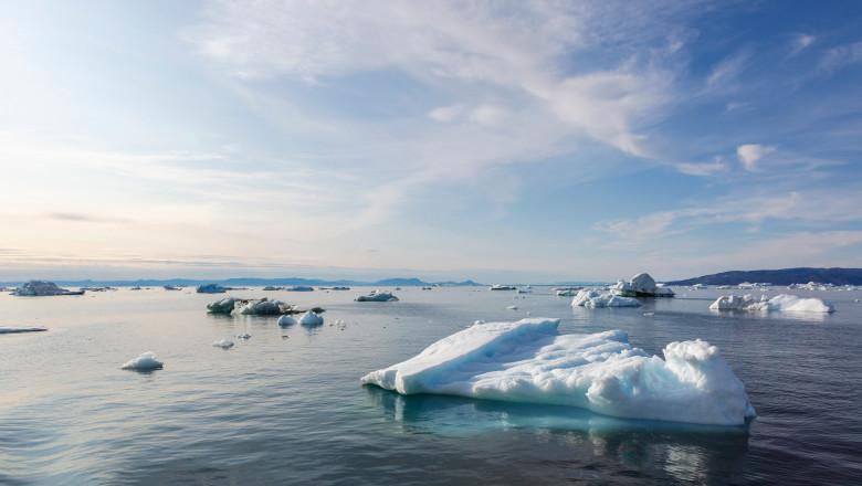 Polar ice melting on sunny Atlantic Ocean Greenland