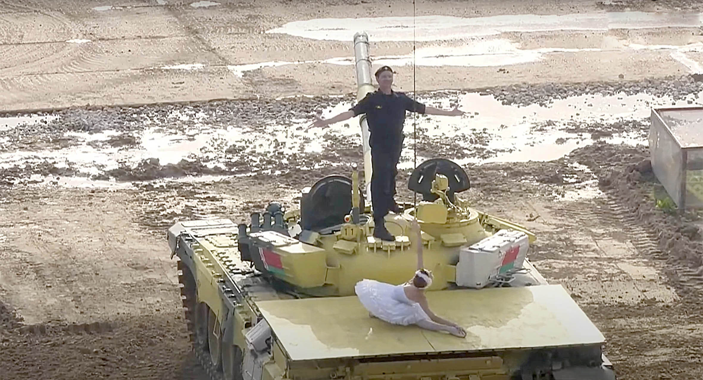 Feared Belarus military in bizarre performance of Swan Lake on top of army tanks