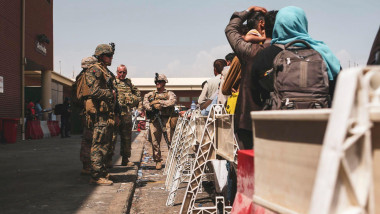 Marines assigned to the 24th Marine Expeditionary Unit (MEU) provide assistance during an evacuation at Hamid Karzai International Airport, Kabul, Afghanistan, Aug. 20. U.S. service members and coalition partners are assisting the Department of State with