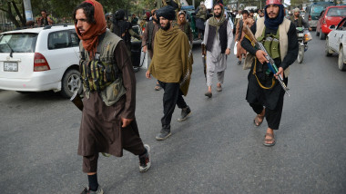 Taliban fighters gather along a street during a rally in Kabul on August 31, 2021 as they celebrate after the US pulled all its troops out of the country to end a brutal 20-year war -- one that started and ended with the hardline Islamist in power