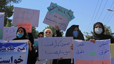 Afghan women hold placards as they take part in a protest in Herat on September 2, 2021. Defiant Afghan women held a rare protest on September 2 saying they were willing to accept the all-encompassing burqa if their daughters could still go to school under Taliban rule.