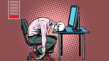 grafica cu un barbat ajuns schelet care sta cu capul pe tastatura